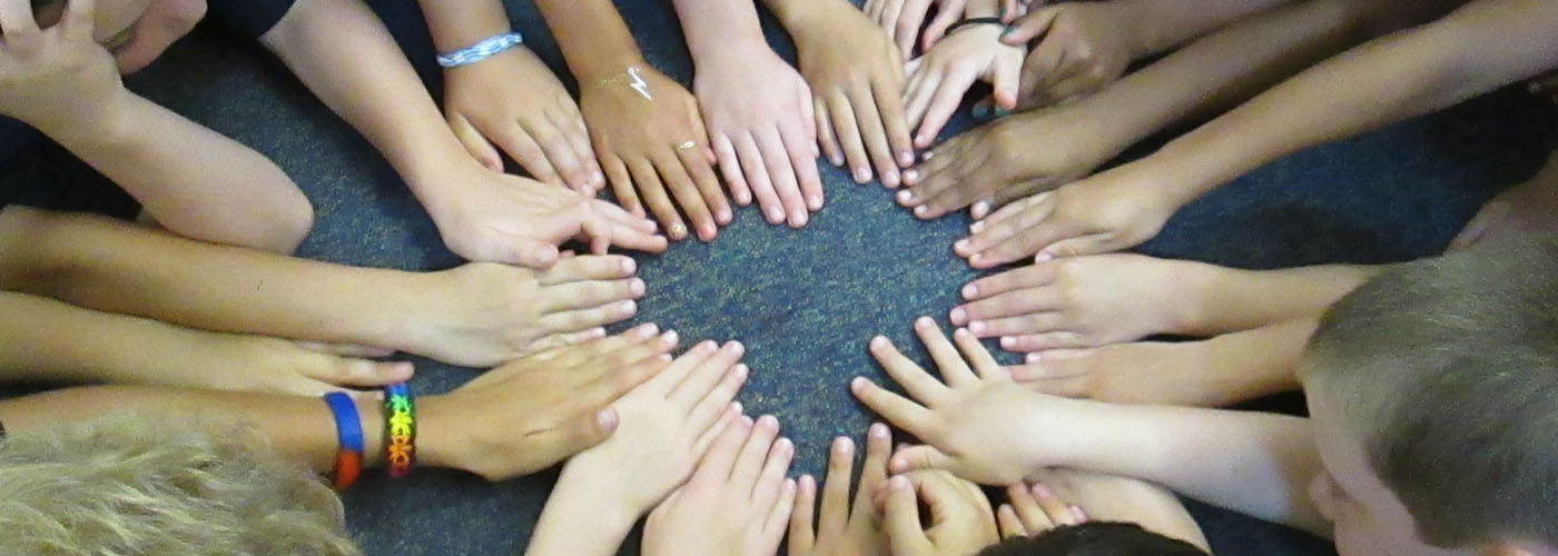 Circle of students hands