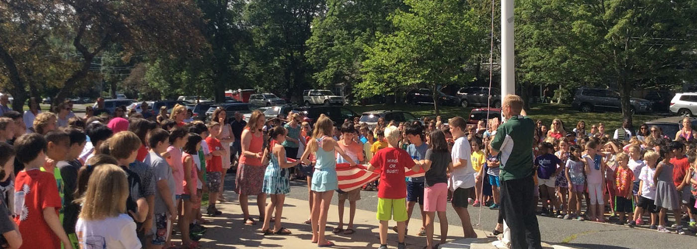 Fiske students posting the flag on the flapole