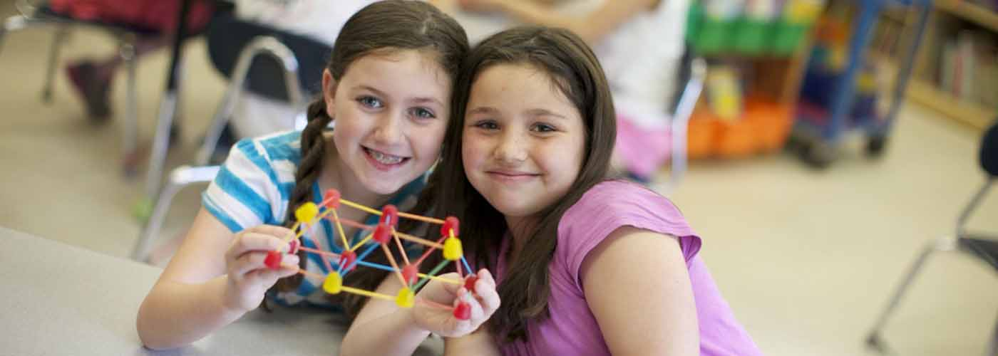 Two Hardy students with a geometic project