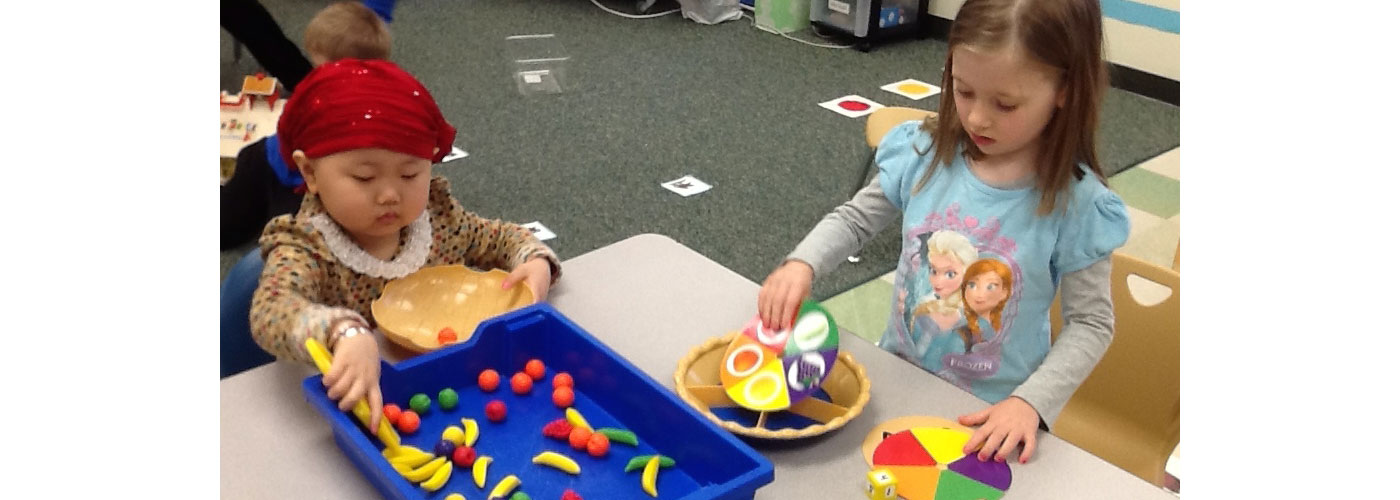 PAWS students practicing fine motor skills at a table
