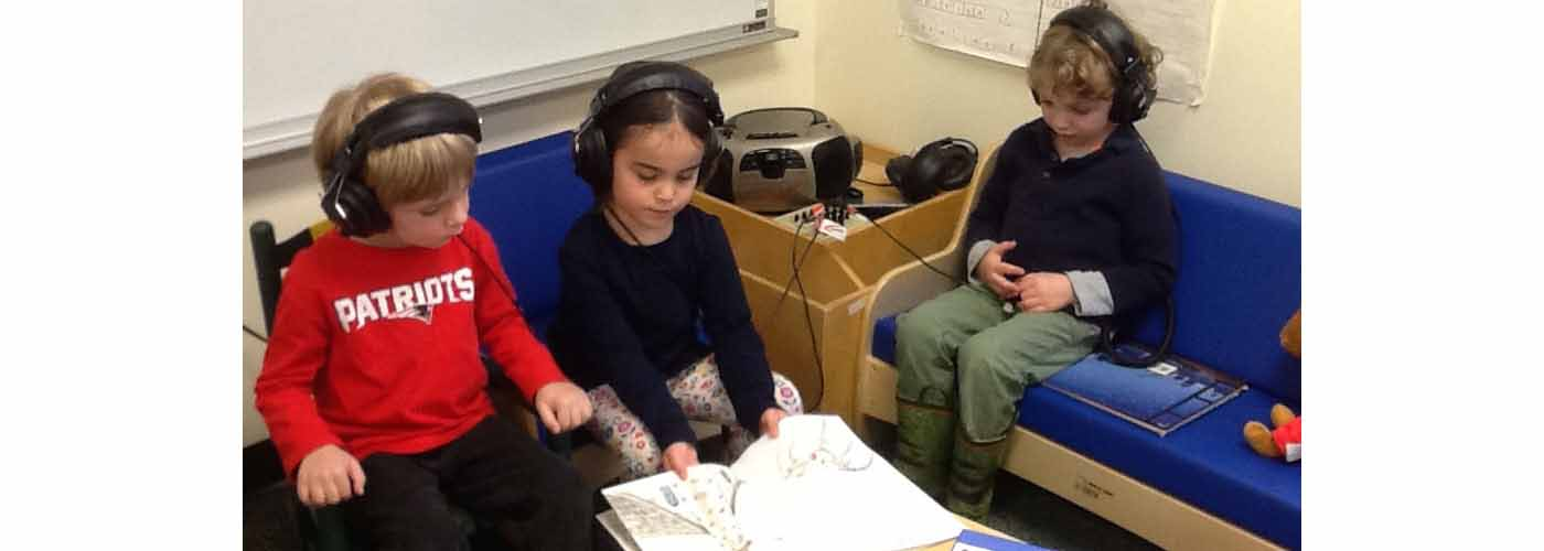 PAWS students listening to an audiobook
