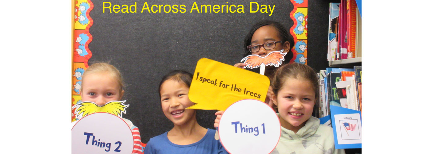 Schofield students holding signs for Read Across America day