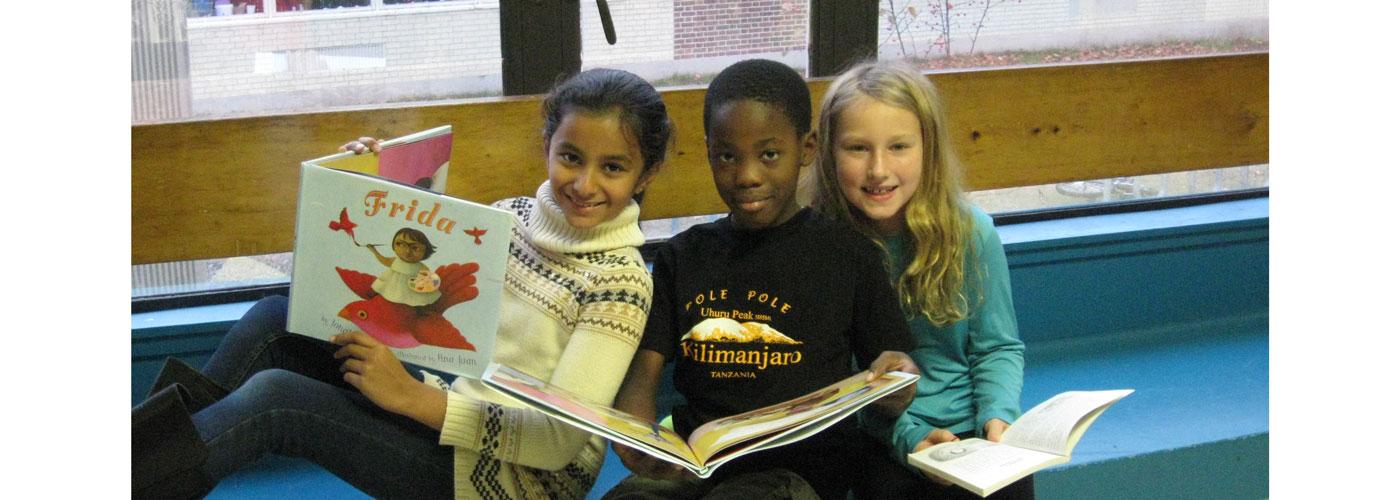 Three Upham students reading