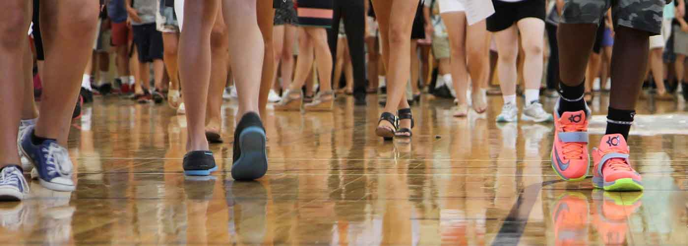 WHS students feet walking on a shiny gym floor