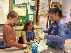 Fourth Grade engineers use shake tables to design and test earthquake-resistant building structures.