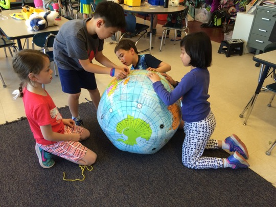 Second graders learn about geography by analyzing different maps