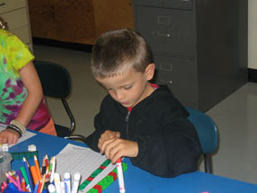 student working on math at a table